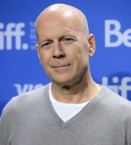 Action hero` Bruce Willis defends violent thrillers