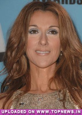 Celine Dion shows off her newborn twins