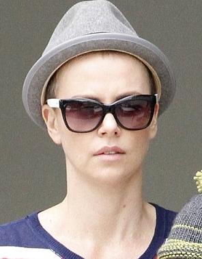 Charlize Theron flaunts buzz cut on day out with mum