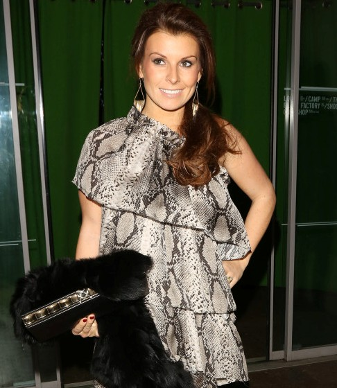 Pregnant Coleen Rooney flaunts toned legs in mini dress at X-mas party