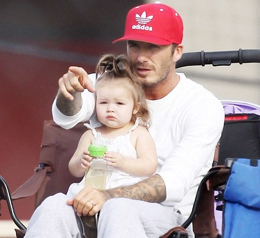Harper swaps fashion for football on day out with doting daddy Becks