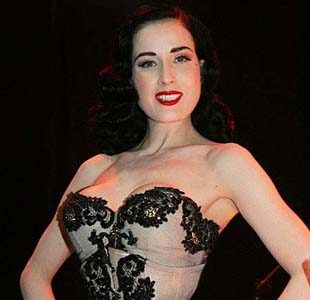 Dita Von Teese gets help from wandering hands in raunchy burlesque revue!