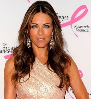 Liz Hurley orders Warnie to change to cricket whites
