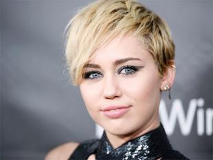 Miley Cyrus gets 'fu***ng high' at SXSW surprise performance