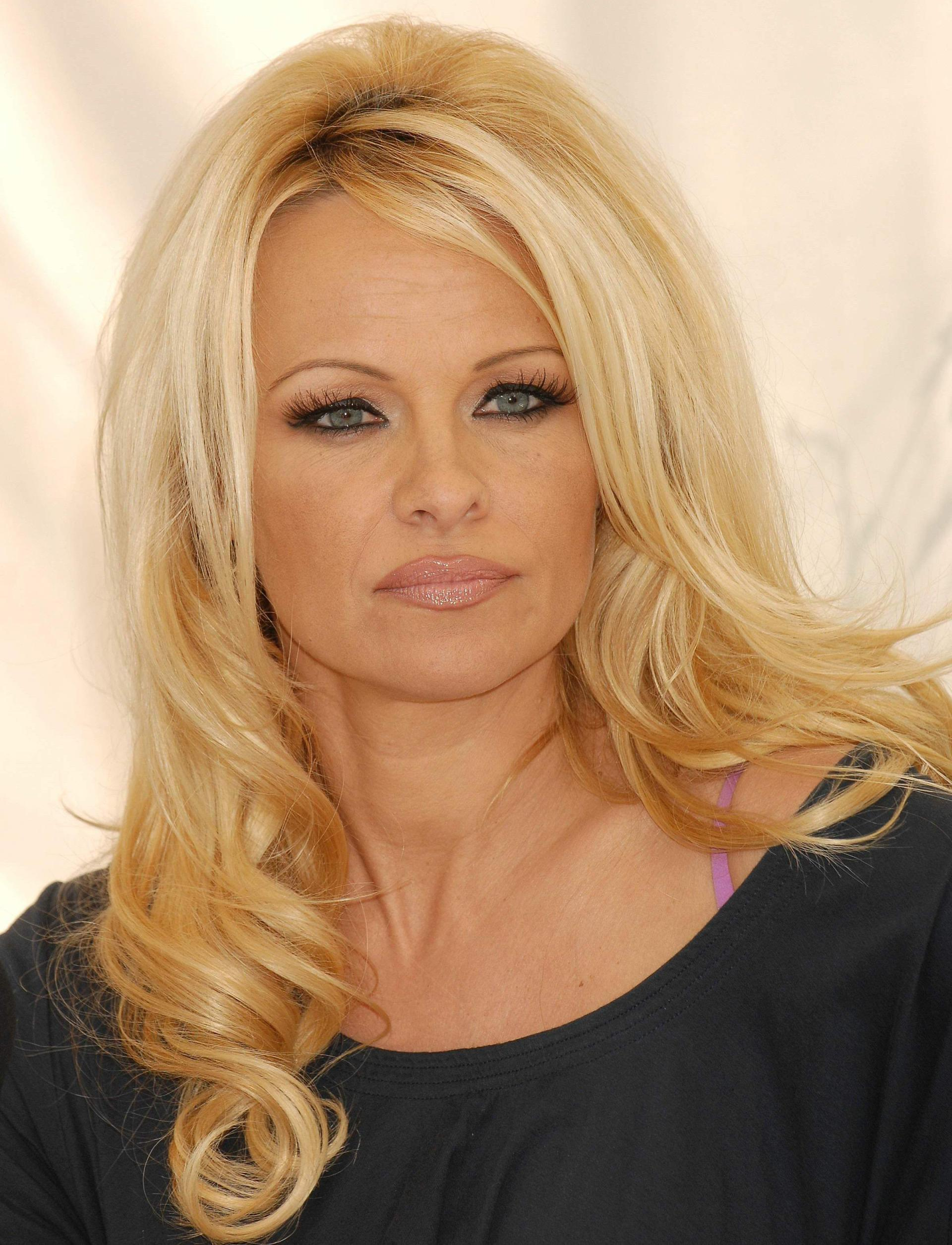 Pamela Anderson wears itty bitty wetsuit for `save whales` campaign Pamela Anderson
