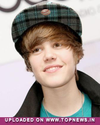 justin bieber heart hands. London, Feb 19 - Fans of teenaged heart-throb singer Justin Bieber will soon