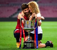Shakira rewards Gerard Pique with a kiss over Soccer win