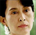 Aung San Suu Kyi says swimming visitor stayed downstairs