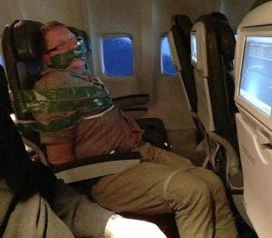 `Drunk` passenger taped to plane seat after ranting flight would crash