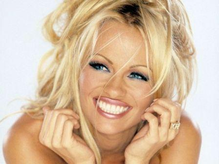 Pamela Anderson goes naked to model her cruelty-free shoes