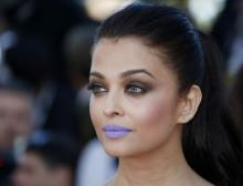 Abhishek feel Aishwarya 'is stunning' with lavender lips at Cannes