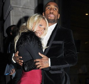 Dad-to-be Jermain Defoe cuddles up to his girlfriend following dinner date