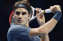 Federer punctures Dimitrov surge to record 300th Grand Slam win